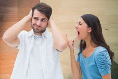 Woman shouting on man while fighting at home Stock Photos