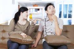 Woman shouting at a man at home Stock Images
