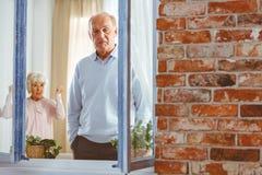 Woman shouting at man. Senior elegant women shouting at men in apartment Royalty Free Stock Photos