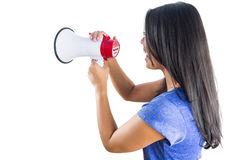 Woman shouting into a megaphone. Against a white background Stock Photo