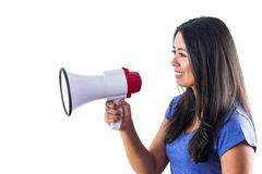 Woman shouting into a megaphone. Against a white background Royalty Free Stock Photos
