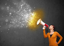 Woman shouting into megaphone Royalty Free Stock Image