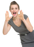 Woman shouting through megaphone shaped hands Royalty Free Stock Image
