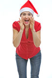 Woman shouting through megaphone shaped hands Royalty Free Stock Images