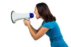 Woman shouting through megaphone Royalty Free Stock Photos