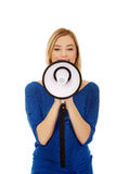Woman shouting with a megaphone Royalty Free Stock Photography