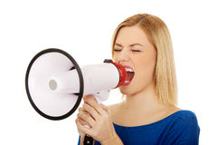 Woman shouting with a megaphone Stock Photo