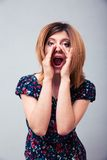 Woman shouting with palms Royalty Free Stock Photo