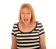 Woman shouting. Portrait of a middle aged woman shouting with an open mouth Royalty Free Stock Images