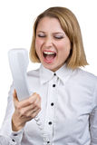 Woman shouting into the telephone receiver Stock Image