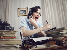 Woman shouting into telephone royalty free stock photo