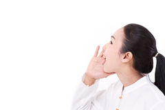 Woman shouting up to blank space Stock Image