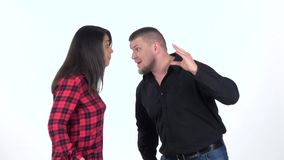 Woman shouts at the man and hit him in shoulder. Slow motion. Woman shouts at the man, waving his arms and hit him in the shoulder. Man makes a gesture with his stock video