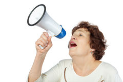 Woman shouts something into a megaphone Stock Photos