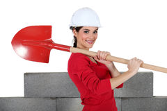 Woman with shovel Stock Image