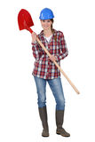 Woman with shovel Stock Photos