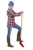Woman with a shovel Royalty Free Stock Photos