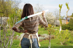 Woman with shovel in garden Royalty Free Stock Photo