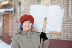 Woman with shovel in winter Royalty Free Stock Photo