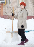 Woman with shovel in winter Royalty Free Stock Image