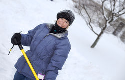 Woman shoveling Royalty Free Stock Images