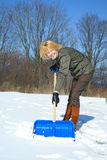 Woman shoveling. Young woman shoveling after a snow storm Royalty Free Stock Photography