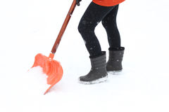 Woman shoveling country road Royalty Free Stock Photos