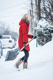 Woman Shoveling her Parking Lot Royalty Free Stock Photos