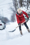 Woman Shoveling her Parking Lot Stock Photos