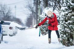 Woman Shoveling her Parking Lot Royalty Free Stock Photo