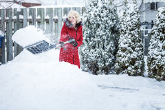 Woman Shoveling her Parking Lot Stock Images