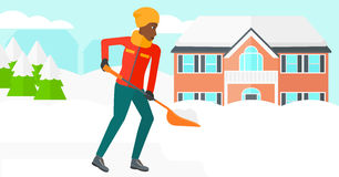 Woman shoveling and removing snow. Royalty Free Stock Photo