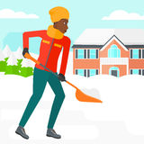 Woman shoveling and removing snow. Royalty Free Stock Images