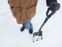 Woman shoveling snow Royalty Free Stock Images