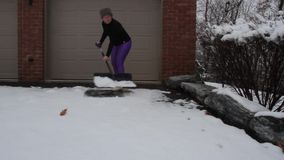 Woman Shoveling Snow stock video footage