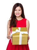 Woman show with big gift box Royalty Free Stock Images