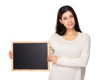 Woman show with black board Stock Image