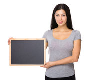 Woman show with black board Stock Photography