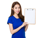 Woman show blank clipboard. Isolated on white background Stock Images