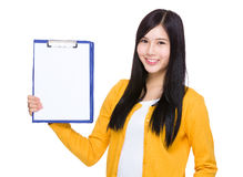 Woman show with blank page on clipboard Stock Images