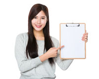 Woman show with blank page of clipboard Stock Images