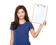 Woman show the blank page on clipboard. Isolated on white background Stock Photo