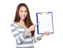 Woman show with blank page of folder Stock Image