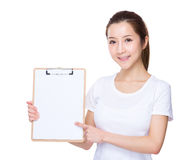 Woman show with blank page Stock Photo