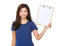 Woman show with blank paper of clipboard. Isolated on white background Stock Image