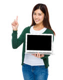 Woman show with blank screen of computer and finger point up Stock Photo