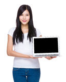 Woman show with blank screen of laptop computer Royalty Free Stock Photo