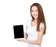 Woman show with blank screen of tablet Royalty Free Stock Photo