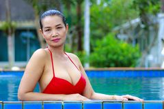 Woman show breast sexy with red bikini at swimming pool. On beach at Bang Boet  beach, Prachuap Khirikhan Province Thailand Stock Image