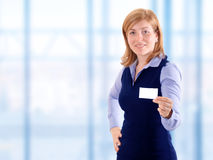 Woman show business card Stock Photo
